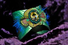 Leather Peacock Feather Cuff With Real Feathers And Beaded Cabochon Accent. $60.00, via Etsy.  I sooooo want this!