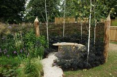 love this wattle fence and garden