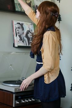 yellow cardigan, polka dot navy dress, bow, record player, retro, outfit, long hair, style, fashion