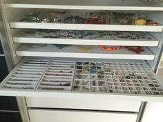 Storing jewelry etc so you can easily see and use it – cluttermonster (IKEA pax pullout with jewelry inserts for necklaces, pendants, pins, and rings)