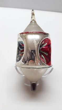 Silver and red lantern shape