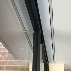 Hidden roller blinds in bi-folding doors Skylight Blinds, Blinds For Windows, Skylights, Blinds And Curtains Living Room, Ceiling Curtains, Conservatory Interiors, Deck Enclosures, Electric Blinds, Modern Blinds