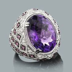 Large Amethyst Cocktail Ring with Diamonds 0.11ct.  This Large Amethyst Cocktail Ring with Diamonds in 14K gold weighs approximately 15 grams and showcases a fabulous 11.75-carat amethyst, 0.76 carats of pink sapphires and 0.11 carats of sparkling round diamonds. Featuring a unique design and a fabulous gold finish, this ladies diamond cocktail ring is available in 14K white, yellow and rose gold. $1.195.00