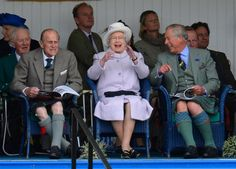 Picture of Prince Philip, Queen Elizabeth and Prince Charles cheer