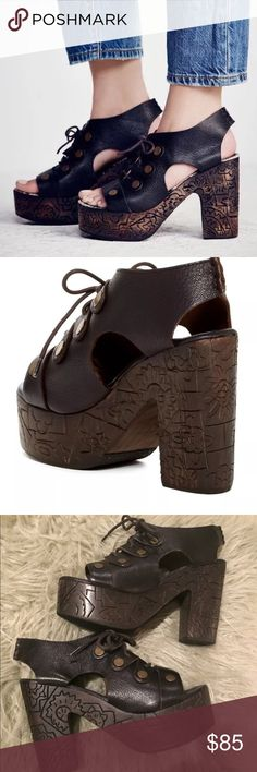 """Free People Farrah platform clog  Sz 7.5 Nib Authentic and never worn.   About This Item   Details  Brassy studs punctuate a lace-up clog sandal shaped from supple leather and designed with cutout sides, blending retro and contemporary styles. A hand-etched wooden platform and heel offer a lofty lift and finish the look with artisanal craftsmanship.   - Open toe  - Lace-up vamp  - Topstitched detail  - Studded vamp detail  - Etched wooden platform heel  - Approx. 4.5"""" heel, 1.75"""" platform…"""