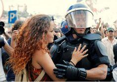 young demonstrator hugs a policeman. Lisbon, Portugal, 2012. What futuristic uniforms