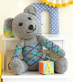 """ARGYLE BEAR It's hard to decide which is cuter: this sweet faced teddy or his pint sized argyle """"sweater"""" that's knitted right on. Pattern available in 60 Quick Knitted Toys. Dinosaur Stuffed Animal, Teddy Bear, Sweater, Knitting, Toys, Cute, Projects, Pattern, Activity Toys"""