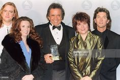 Photo taken 05 December 1990 of US country singer Johnny Cash (C) posing with his son John Carter Cash (L), his wife June Carter Cash (2d L), his daughter Rosanne and her husband Rodney Crowell, after receiving the Grammy Legend Award. Johnny Cash died at the age of 71 in a hospital in Nashville 12 September 2003, CNN said quoting a hospital spokesman. At the age of 48 Cash became the youngest living inductee into the Country Music Hall of Fame. AFP PHOTO MARIA BASTONE