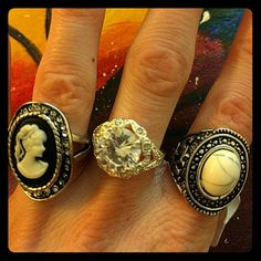 3 gourgeous vintage rings, size 18-19 Thus listing is for a set of 3 beautiful vintage style rings, sizes 18-19. One ring has a tag, but all rings are new and unworn. The one with the tag has a big pearl. One ring has a picture of a queen or a princess in it. One ring is a Large fake diamond (middle). All beautiful rings, but too big for me sadly. Rings are fake silver. Jewelry Rings