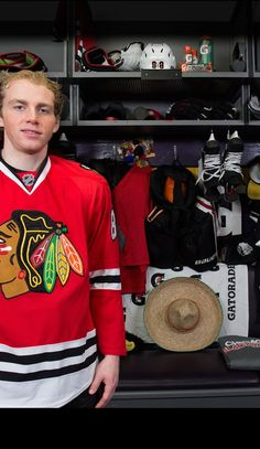 Patrick Kane trying on headphones and dancing. Just… no words. This idiot.