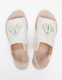 Tassel loafer sandal from Terhi Polkki with open toed styling, padded insole, and tassel loafer details.