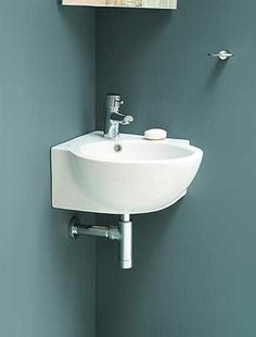 Corner sinks are practical, pretty and space saving ideas for small bathroom design Corner Pedestal Sink, Corner Sink Bathroom, Small Bathroom Sinks, Diy Bathroom Decor, Modern Bathroom Design, Bathroom Ideas, Tiny Half Bath, Bathroom Designs Images, Modern Sink