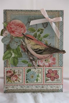graphic 45 botanical tea paper collection with a bit of fussy cutting, lace and ribbon bow