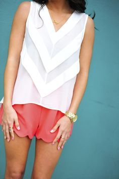 Coral shorts with a crisp white tank