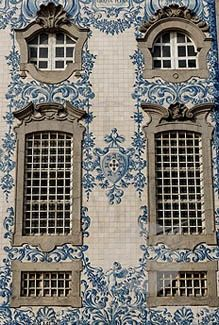 """Portuguese tiles, or """"azulejos"""". Tiles on walls are found throughout Portugal. The arrangements have told the story of the Portuguese people for centuries. Typically, they are hand-painted in blue and white, but some are done in very rich, bright colors. Delft, Mosaic Tiles, Wall Tiles, Portuguese Tiles, Portuguese Culture, Beautiful Buildings, Windows And Doors, Architecture Details, Shades Of Blue"""