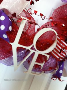 Quick Valentine wreath tutorial using deco mesh and ribbon! Super easy!