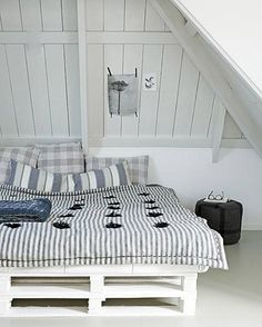 Bed made from recycled pallets | Remodelista