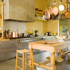 We love the beautiful wood island in this country kitchen! More country kitchen ideas: http://www.bhg.com/kitchen/styles/country/country-kitchen-ideas/?socsrc=bhgpin072413woodisland=14