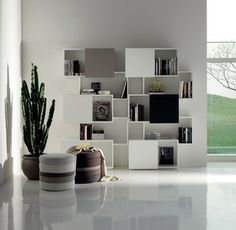 The Piquant modern Bookcase, by Andrea Lucetello for Cattelan Italia, offers both hidden and open areas through the sliding door compartments, discerning functionality into its dynamically designed facade. Home Decor Furniture, Furniture Design, Italian Furniture Stores, Casa Milano, Walnut Doors, Italia Design, Modern Bookcase, Cubes, Home Interior Design