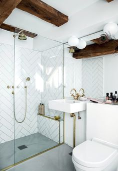 Elegant bathroom with wall tiles, beautiful brass faucets and wood ceiling. Pinterest: pearlxoxoxo
