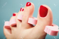 Foot Pedicure Applying Woman's Feet With Red Toenails In Pink ...