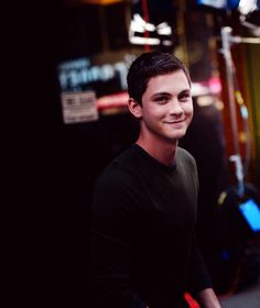 I don't know why I picture Logan to be such an introvert. I don't want to him to, being and extrovert and all, but I'll make it work.  {Logan Lerman}