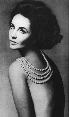 Elizabeth Taylors bare back displays a fortune in cultured pearls from Tiffanys. Photo by Richard Avedon, Harpers Bazaar, 1960. jamiemonteith