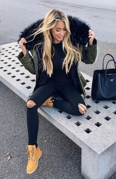 nice winter jacket with ripped black jeans winter outfit
