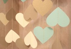 Gold Garland, Paper Garland, Wedding Garland, Bridal Shower Decor, Heart Garland, Heart Bunting, Mint & Gold Party Decor, Rustic Decor by MailboxHappiness on Etsy https://www.etsy.com/listing/193250389/gold-garland-paper-garland-wedding