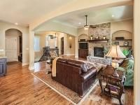 Sedona V Floor Plan - great room, curved arched doorways, hardwood floors, stone fireplace, custom built in cabinetry, great light fixtures, and open floor plan living.