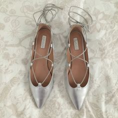 topshop pointed lace up flats New in box. Sticker tags on bottom of the shoe.  Silver. Soft leather. Lace up. Pointed toe. Comes in box. US 8.5/euro 39. True to size. Dark spots from rubbing shown in photos. No trades or pay pal. Topshop Shoes Flats & Loafers