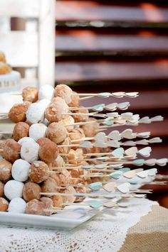 We love the arrow shaped wood holding skewers of doughnut holes. Not to mention lovely glazes you can dip them in!