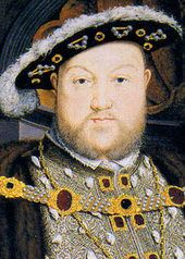 Flat Cap — A hat that is flat with soft crown and moderately broad brim often associated with King Henry VIII.