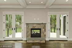This stone surround gas fireplace is two sided so guests can enjoy the warmth from the living room or the back deck. @303 Niblick Dr SE, Vienna, VA 22180 @paulineknipe @catharinevia