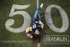 Senior photo, girl on football field. www.spokanefamilyphoto.com/senior