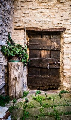 Old door from a village in Italy. This is a great looking scene, really showing off the beauty that this old door has within this idyllic setting.