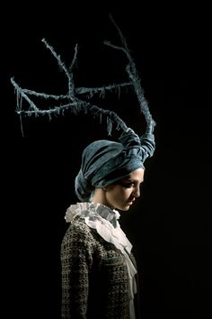 not only is wearing antlers fashionable now but rotting antlers! oh boy