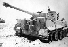 Tiger1 winter camo. Note the gapping hole in the turret where the smoke dischargers normally are mounted. Also scars on the turret, penetrations on the right hull, and damage and a missing fiefel air filter on the rear hull.