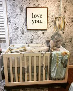 Boy Nursery: House of Belonging- Love You Sign, Chasing Paper- wild thing wallpaper, target- white crib, striped- crib skirt and pillow, pottery barn- crib bumper, fabric mobile, elephant