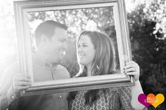 Picture frame engagement prop.  Cute session ideas!  Romantic Sunset Engagement.  #Tailgating, #Texas State and Big Dogs = #Engagement Fun! | San Antonio Wedding Photographer Kelly Cameron » Kelly Cameron  http://kellycameron.net