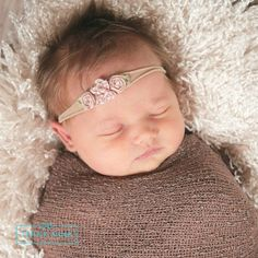 Our fancy flowernylon baby headband is so soft and stretchy and will not leave any marks on your babies head. SHOP unique newborn headbands at http://thinkpinkbows.com/products/petite-flower-bow-on-skinny-nylon-headband | Shabby Chic | Baptism | Christmas | Vintage