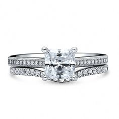 This solitaire with side stones ring set's petite design embodies refined opulence framed with endlessly eye-catching brilliance. Made of rhodium plated silver. Features carat princess cut clear cubic zirconia in setting. Diamond Promise Rings, Diamond Wedding Bands, Solitaire Rings, Ring Set, Ring Verlobung, His And Hers Rings, Thing 1, Anniversary Bands, Pearl Studs