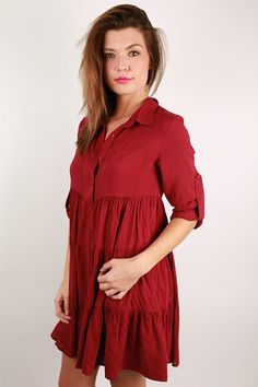 We're in love with this ruffled button down dress! Wear it with a cute cardi, a glam necklace, and booties. You'll look polished and adorable for any occasion!