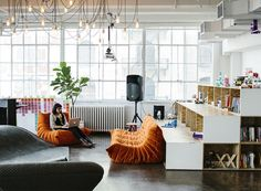 NYC firm MCDC designed littleBit's Chelsea office of with Ligne Roset Togo sofas and overhead fixture by Tech Lighting