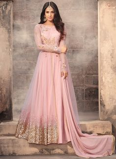 Light Pink Embroidered Net Anarkali Suit features a beautiful net top alongside a santoon bottom and inner. A chiffon dupatta completes the look. Embroidery work is completed with zari, thread, and stone.