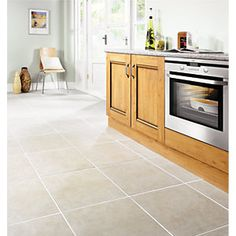 This Wickes Vienna Taupe Matt Ceramic Floor Tile 450x450mm works with a variety…