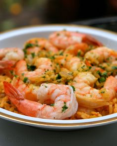 Shrimp rice  Arroz con camarones or shrimp rice is a classic Ecuadorian and South American dish from the coastal areas consisting of rice cooked in a shrimp broth and mixed with shrimp, sautéed onions, peppers, tomatoes, garlic, cumin, achiote and parsley.