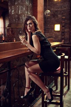 Young woman sitting at the bar