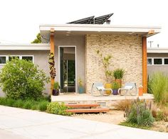 Natural elements add interest to this stylish contemporary home. More exterior inspiration: http://www.bhg.com/home-improvement/exteriors/curb-appeal/best-exterior-house-color-schemes/?socsrc=bhgpin042013contemporaryfacade=10