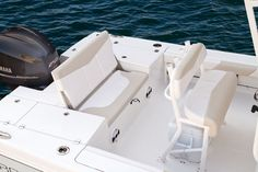 Robalo 246 Cayman: Three-across seating is presented by flipping up the center of the casting deck. Speakers to the Jensen stereo are just below. Boat Restoration, Yacht Builders, Bay Boats, Electric Boat, Deck Boat, Charter Boat, Boat Accessories, Boat Stuff, Center Console